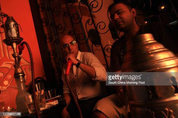 Patrons enjoying shisha at shisha bar Sahara in Soho, Central. 21SEP11