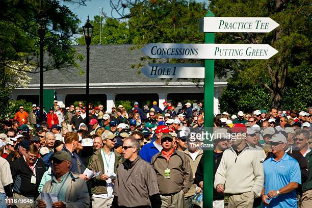 Patrons enter the gates at the Augusta National Golf course during practice day for this week's Masters Golf Tournament in Augusta Georgia Tuesday...