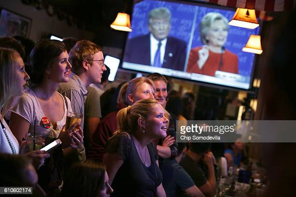 Patrons fill the Capitol Lounge two blocks from the US Capitol to watch the first presidential debate between Republican candidate Donald Trump and...