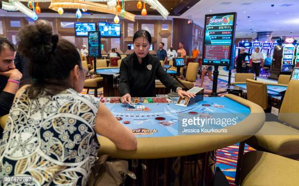 Patrons gamble inside the Hard Rock Hotel and Casino previously the Trump Taj Mahal on June 29 2018 in Atlantic City New Jersey The Hard Rock is one...