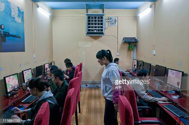 Patrons gather to use computers at an Internet cafe in Kunming southwest China's Yunnan province on April 1 2010 Cybercafes in China that admit three...