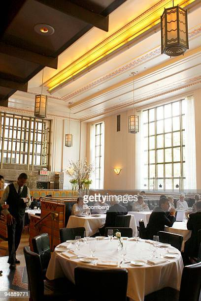Patrons have lunch at Eleven Madison Park a restaurant located at 11 Madison Avenue in New York US on Friday May 30 2008 Danny Meyer's Eleven Madison...