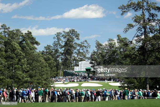 Patrons in a crosswalk on the seventh hole during the second round of the 2017 Masters Tournament at Augusta National Golf Club on April 7 2017 in...