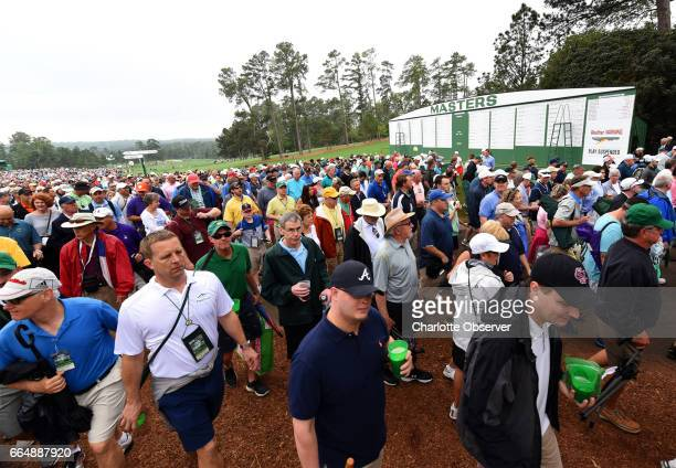 Patrons leave the course at Augusta National Golf Club as inclement weather approaches on Wednesday April 5 2017 Patrons were notified by a horn and...