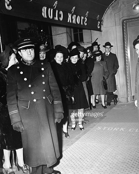 Patrons line up behind the doorman under the canopy of the Stork Club 3 East 53rd Street New York New York early to mid 1940s