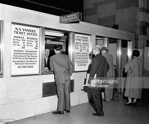 Patrons line up to purchase tickets for the New York Yankees 1957 season and individual MLB games at the Yankees' ticket office located at Grand...
