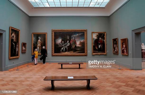 """Patrons look at paintings on display during a press viewing of """"A New Look at Old Masters"""" a newly installed gallery for European Paintings, on..."""