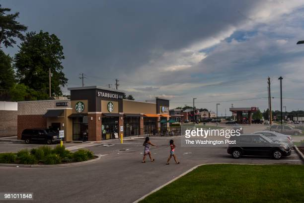 Patrons make their way across the parking lot of this newly built Starbucks on the northern edge of Ferguson on Sunday May 27 in Ferguson MO