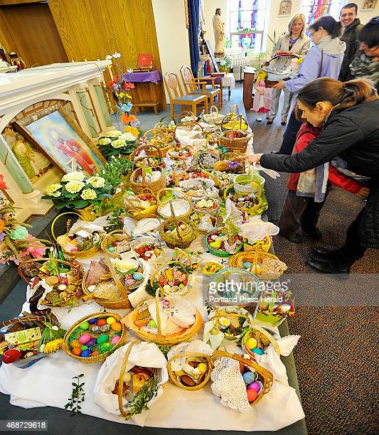 Patrons of the St Louis Catholic Church admire the Easter Baskets they placed on base of the alter before the service that concludes with the...