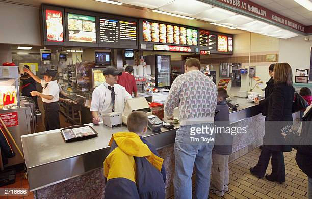 Patrons order their meals at a McDonald's November 10 2003 in Des Plaines Illinois McDonald's said it is not happy with the word McJob which is...