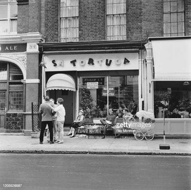 Patrons outside Sa Tortuga a fashionable Caribbean style coffee bar on the King's Road in Chelsea London September 1959