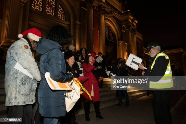 Patrons perform during 'The Mobile Hallelujah' as part of Make Music Winter at the Metropolitan Museum of Art on December 21 2018 in New York City