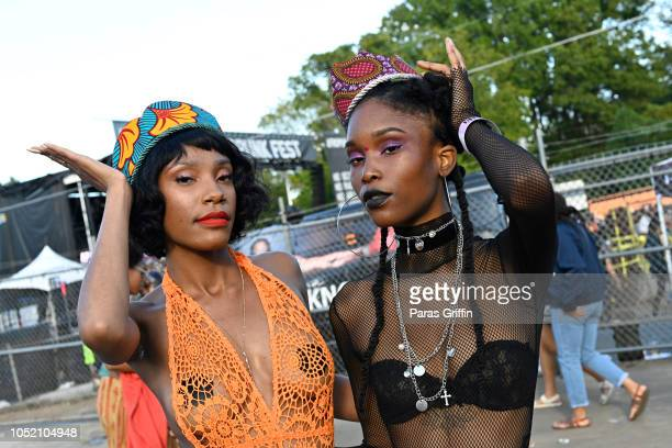Patrons pose for a photo at 2018 AfroPunk Festival Atlanta Carnival of Consciousness at 787 Windsor on October 13 2018 in Atlanta Georgia