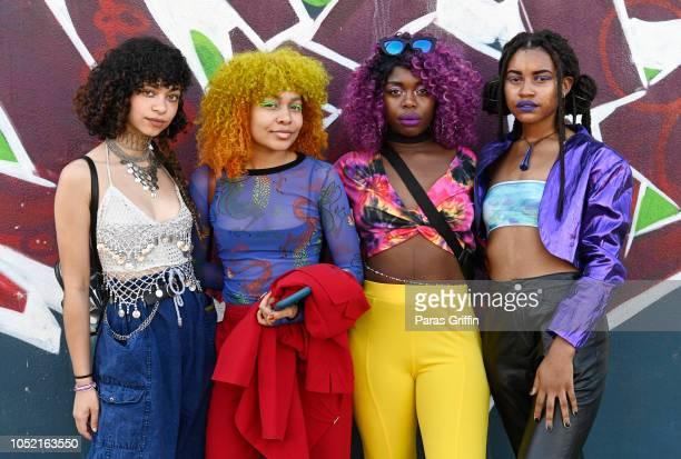 Patrons pose for a photo at 2018 AfroPunk Festival Atlanta Carnival of Consciousness at 787 Windsor on October 14 2018 in Atlanta Georgia