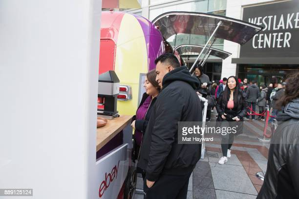 Patrons receive hot chocolate with custom images in the foam during the 'Did You Check eBay' Holiday Airstream tour at Westlake Center Plaza on...