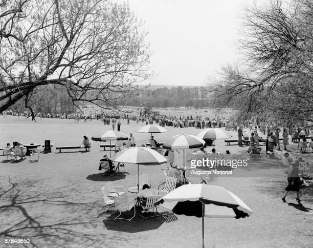 Patrons relax behind the clubhouse during the 1947 Masters Tournament at Augusta National Golf Club in April 1947 in Augusta Georgia