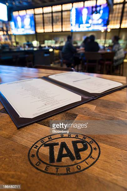 Patrons sit at a table in the Tap sports bar at MGM Resorts International's MGM Grand Detroit hotel in Detroit, Michigan, U.S., on Wednesday, Oct....