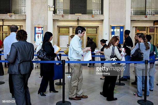 Patrons stand in line at the US Postal Service James A Farley Post Office in New York US on Thursday April 15 2010 The US Postal Service may run out...