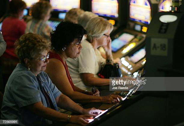 Patrons test their luck with a card game slot machine at the renovated Gulfstream Park Racing Casino November 15 2006 in Hallandale Beach Florida The...
