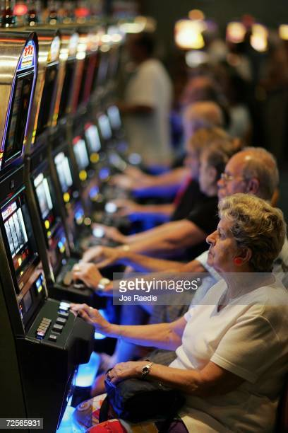 Patrons test their luck with slot machines at the renovated Gulfstream Park Racing Casino November 15 2006 in Hallandale Beach Florida The slot...