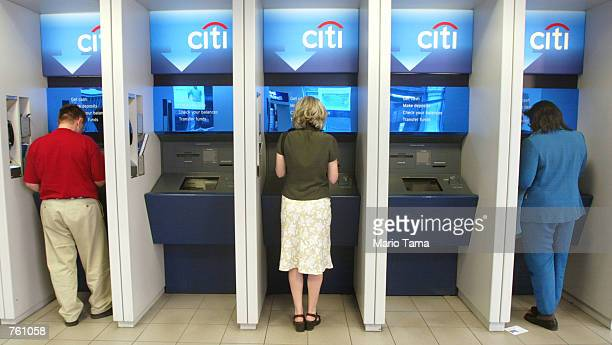 Patrons use the automated teller machines at a Citibank branch April 18, 2002 in New York City. The FBI reported that officials had received threats...