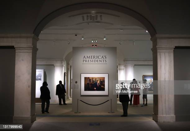 Patrons view a portrait of former U.S. President Donald Trump in the America's Presidents exhibition at the National Portrait Gallery as the...