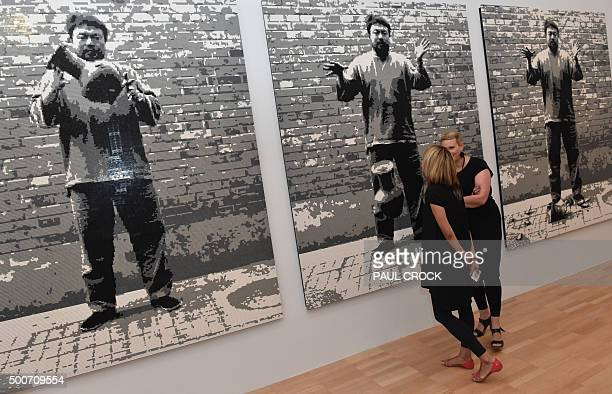 Patrons view 'Dropping a Han Dynasty Urn' a piece made of Lego blocks by Chinese dissident artist Ai Weiwei following the launch of the joint...