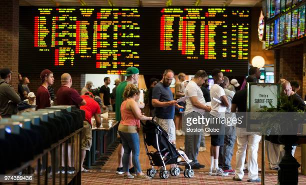 Patrons wait in long lines inside Vegas Sports Betting at Delaware Park Racetrack in Stanton DE on June 10 2018 In May the US Supreme Court...