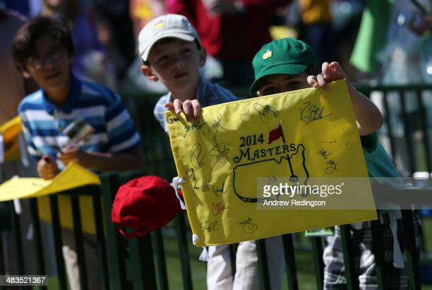 Patrons wait near the range for autographs during a practice round prior to the start of the 2014 Masters Tournament at Augusta National Golf Club on...
