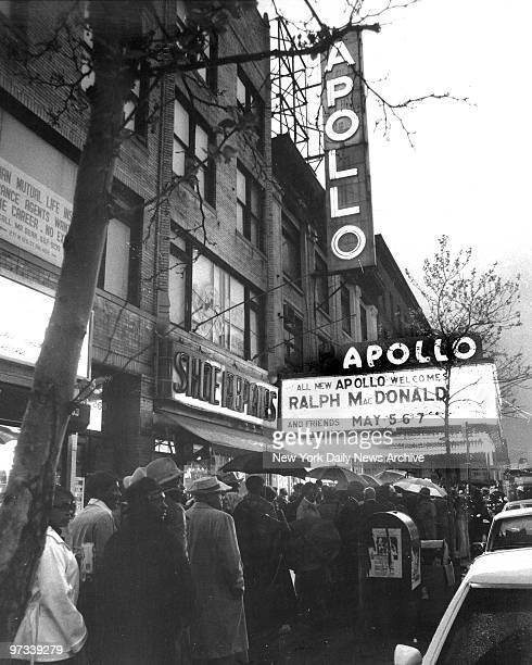 Patrons wait outside the Apollo Theatre at 252 West 125th Street Harlem for opening preformance