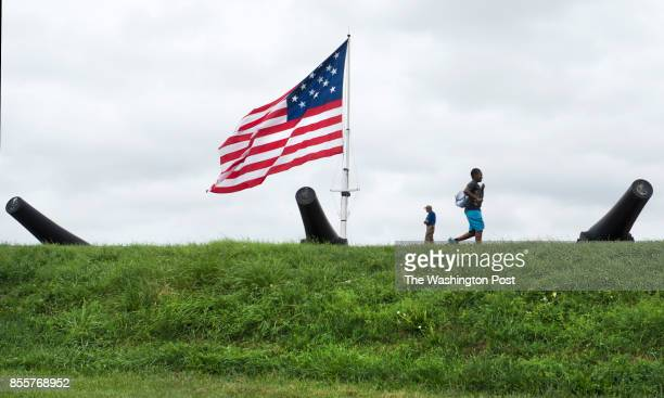 Patrons walk among the canons and an merican flag flown at Fort McHenry in Baltimore MD on September 9 2014 This week marks the 200th anniversity of...