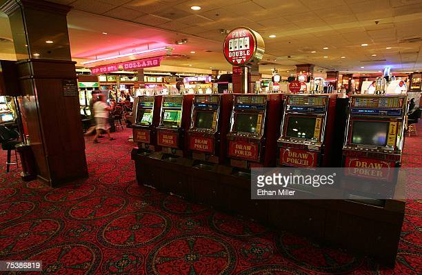 Patrons walk by outofservice video poker machines at the New Frontier Hotel Casino July 12 2007 in Las Vegas Nevada The 984room property in operation...