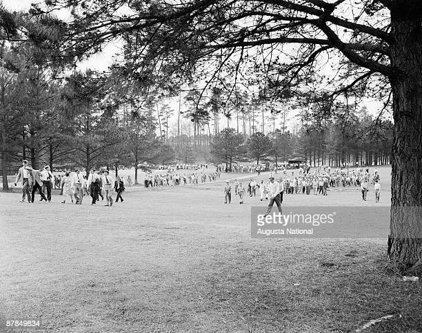 Patrons walk the course during the 1948 Masters Tournament at Augusta National Golf Club in April 1948 in Augusta Georgia