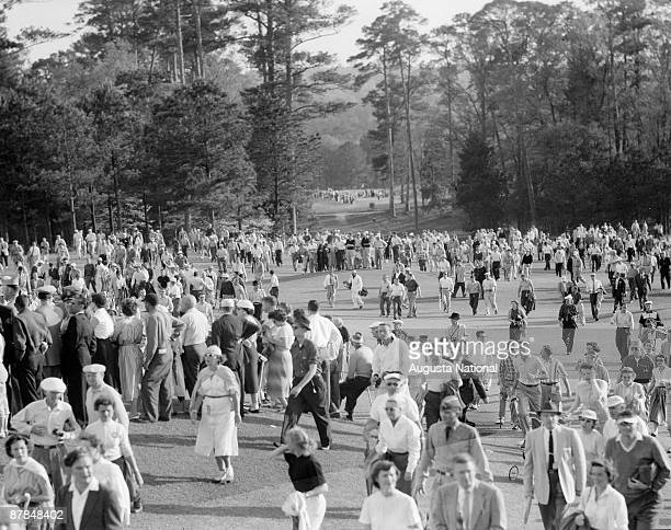 Patrons walk the course during the 1956 Masters Tournament at Augusta National Golf Club in April 1956 in Augusta Georgia