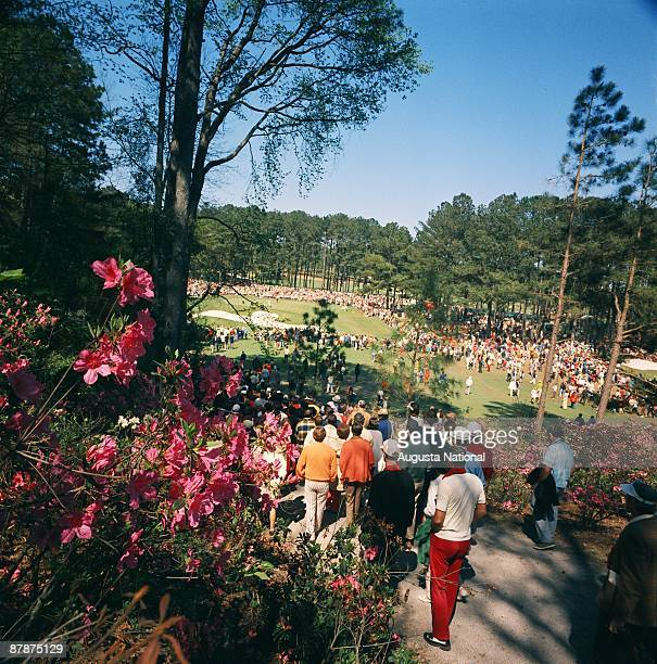 Patrons walk the path beside the sixth hole during the 1972 Masters Tournament at Augusta National Golf Club in April 1972 in Augusta Georgia