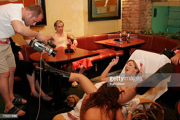 Patrons watch as a live sex show is being broadcast live over the web in the club room of Big Sister on August 23 2006 in Prague Czech Republic The...