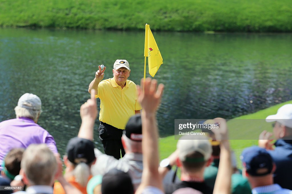 Patrons watch as Jack Nicklaus celebrates his hole-in-one on the fourth hole during the Par 3 Contest prior to the start of the 2015 Masters Tournament at Augusta National Golf Club on April 8, 2015 in Augusta, Georgia.