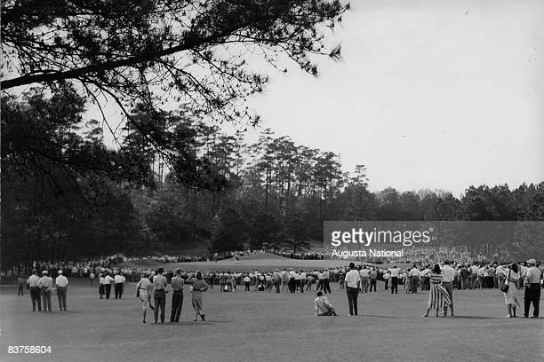 Patrons watch play on the 15th green during the 1948 Masters Tournament at Augusta National Golf Club in April 1948 in Augusta Georgia
