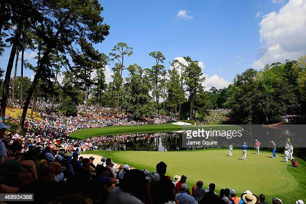 Patrons watch the play during the Par 3 Contest prior to the start of the 2015 Masters Tournament at Augusta National Golf Club on April 8 2015 in...