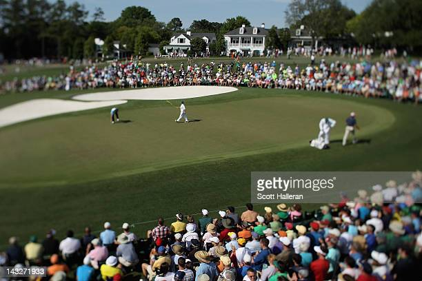 Patrons watch the play on the ninth green during the final round of The Masters at Augusta National Golf Club on April 8 2012 in Augusta Georgia
