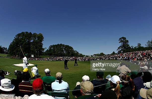 Patrons watch the play on the second hole during the final round of The Masters at the Augusta National Golf Club on April 8 2007 in Augusta Georgia