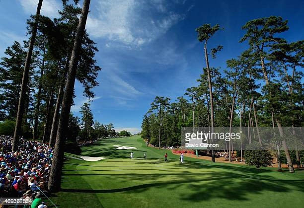 Patrons watch the play on the tenth hole during the third round of the 2015 Masters Tournament at Augusta National Golf Club on April 11 2015 in...