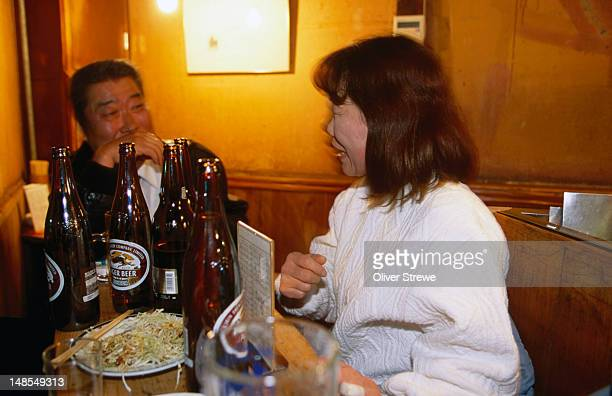 Patrons with a meal and a beer, or two in the Tonchan izakaya in Kochi City.