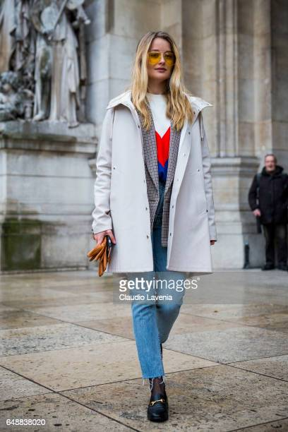 Patrycja Rychlik is seen wearing an H and M sweater and Gucci shoes before the Stella McCartney show at the Grand Palais during Paris Fashion Week...