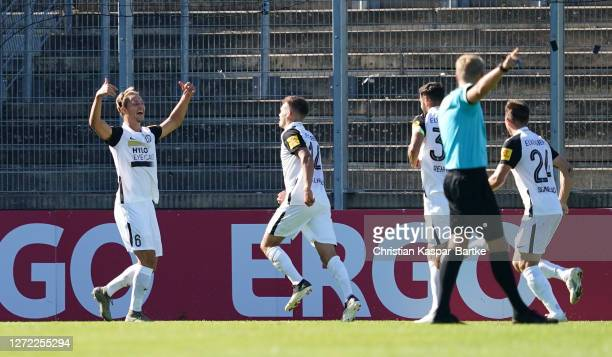 Patryk Dragon of SV Elversberg celebrates after scoring his team's second goal during the DFB Cup first round match between SV Elversberg and FC St....