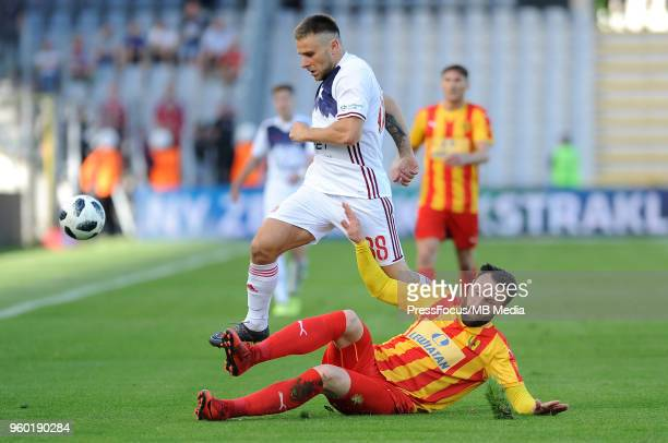 Patryk Malecki of Wisla Cracow is tackled by Zlatan Janjic of Korona Kielce during Lotto Ekstraklasa match between Korona Kielce and Wisla Cracow on...