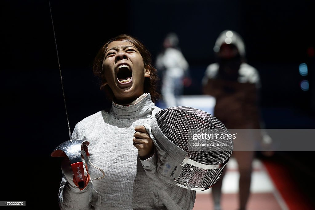 Patsara Manuya of Thailand reacts during her fight with Novi Susanti of Indonesia in the women's fencing team sabre semifinals at the OCBC Arena Hall during the 2015 SEA Games on June 7, 2015 in Singapore.