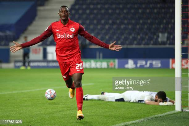 Patson Daka of RB Salzburg celebrates after scoring his sides third goal during the UEFA Champions League Play-Off second leg match between RB...