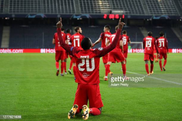 Patson Daka of RB Salzburg celebrates after scoring his sides third goal during the UEFA Champions League PlayOff second leg match between RB...