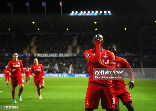Patson Daka of RB Salzburg celebrates after scoring his team's first goal during the UEFA Champions League group E match between KRC Genk and RB...